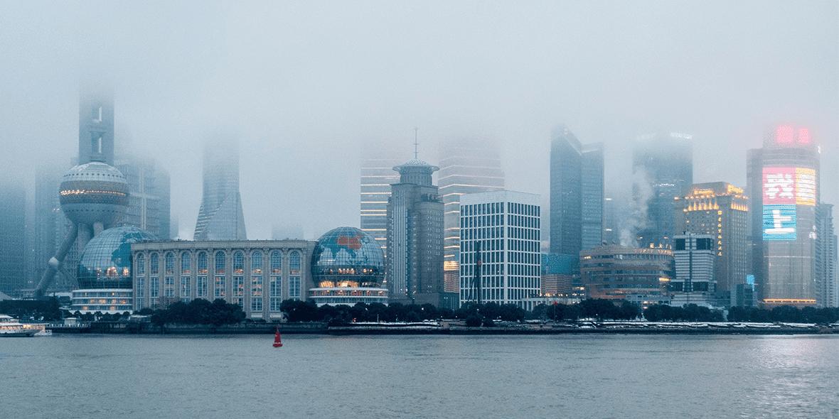 Chinese cityscape with skyscrapers obscured by fog