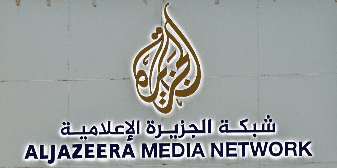 Al Jazeera logo on exterior of building
