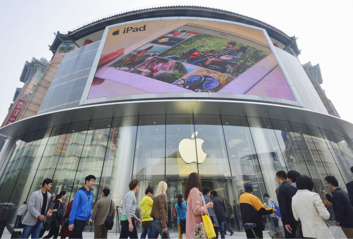 People in front of an Apple Store in Beijing
