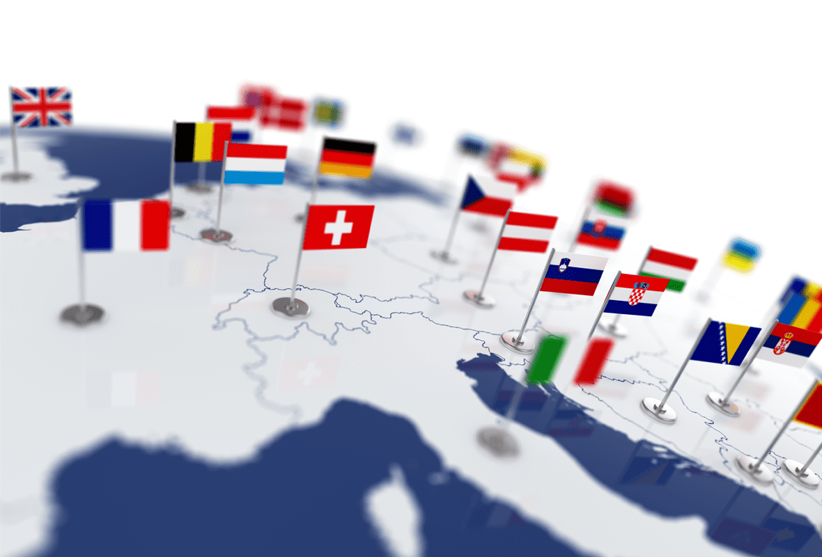 Flags of European countries sticking out of a globe